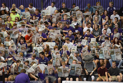 Student fans get ready to throw shredded paper up in the air before the game starts on September 16, 2014 at Ahearn Field House.  (Rodney Dimick | The Collegian)