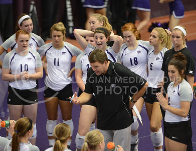 Sophomore middle blocker Katie Reininger gets excited while the rest of the team is solemn on Sept. 16, 2014 at Ahearn Field House.  (Rodney Dimick | The Collegian)