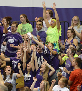 Student fans reach for a t-shirt on Sept. 16, 2014 at Ahearn Field House.  (Rodney Dimick | The Collegian)
