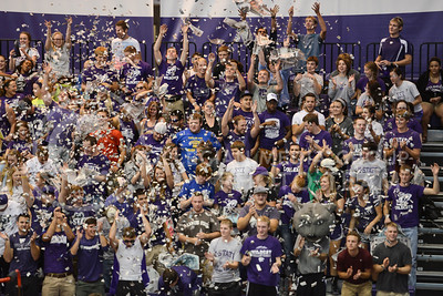 Student fans throw shredded paper up in the air before the game starts on September 16, 2014 at Ahearn Field House.  (Rodney Dimick | The Collegian)