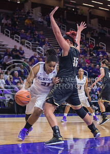 K-State forward Ashley Jones goes around Emporia State forward Merissa Quick during the game against Emporia State  at Bramlage Coliseum on Nov. 3, 2014. K-State defeated Emporia State 54-50. (George Walker | The Collegian)