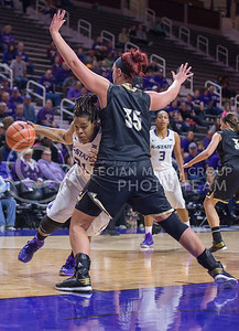 K-State forward Ashley Jones goes around Emporia State guard Kyrstie Miller during the game against Emporia State  at Bramlage Coliseum on Nov. 3, 2014. K-State defeated Emporia State 54-50. (George Walker | The Collegian)