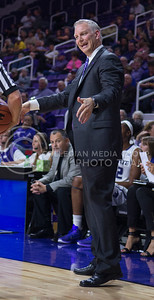 Women's basketball head coach Jeff Mittie talks to his team during the game against Emporia State  at Bramlage Coliseum on Nov. 3, 2014. K-State defeated Emporia State 54-50. (George Walker | The Collegian)