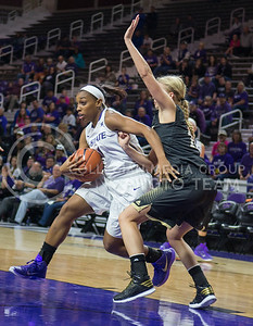 K-State guard Haley Texada goes around an Emporia State player for a shot at the basket at Bramlage Coliseum on Nov. 3, 2014 during the game against Emporia State. K-State defeated Emporia State 54-50. (George Walker | The Collegian)