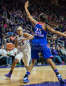 Senior guard Ashia Woods looks for a passageway to the basket on Jan. 11, 2014 at Bramlage Coliseum.  Woods lead the team in points against KU with a total of 15 points.  (Rodney Dimick | The Collegian)
