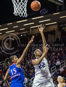 Sophomore forward Breanna Lewis lays up the ball on Jan. 11, 2014 at Bramlage Coliseum.  Lewis had a total of eight points in the game against KU.  (Rodney Dimick | The Collegian)