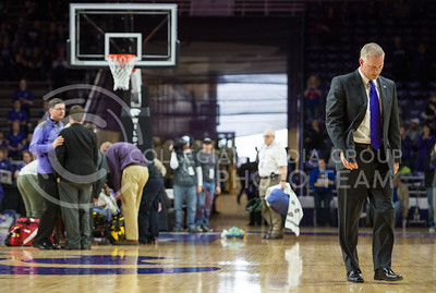 Head coach Jeff Mittie walks away concerned about senior guard Haley Texada who was injurned on Jan. 11, 2014 at Bramlage Coliseum.  (Rodney Dimick | The Collegian)