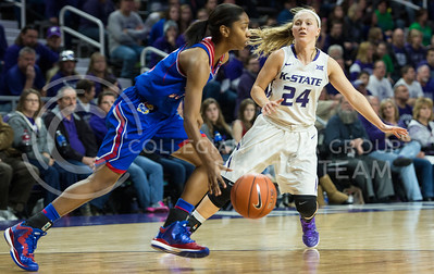 Sophomore guard Kindred Wesemann follows an opponent down the court on Jan. 11, 2014 at Bramlage Coliseum.  K-State won against KU 58-52 in an exciting game.  (Rodney Dimick | The Collegian)