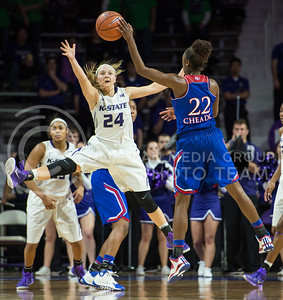 Sophomore guard Kindred Wesemann uses every limb to defend a KU opponent on Jan. 11, 2014 at Bramlage Coliseum.  Wesemann was a prominent asset to the team with four assists and 11 total points during the game against KU.  (Rodney Dimick | The Collegian)