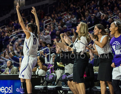 The team celebrates after a successful play on Jan. 11, 2014 at Bramlage Coliseum.  The Wildcats beat KU 58-52 though they were down seven points after the first half.  (Rodney Dimick | The Collegian)