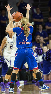 Sophomore guard Kindred Wesemann stretches to defend an opponent n Jan. 11, 2014 at Bramlage Coliseum.  K-State beat KU 58-52.  (Rodney Dimick | The Collegian)