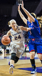 Sophomore guard Kindred Wesemann powers around a defender on Jan. 11, 2014 at Bramlage Colisuem.  Wesemann finished the game against KU with a total of 11 points.  (Rodney Dimick | The Collegian)