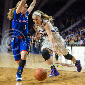 Sophomore guard Kindred Wesemann maneuvers around a defender on Jan. 11, 2014 at Bramlage Coliseum.  The Wildcats beat KU 58-52.  (Rodney Dimick | The Collegian)