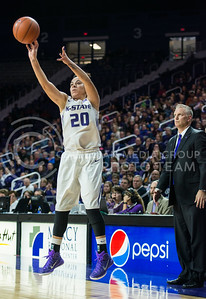 Junior guard Brianna Craig attempts a three while head coach Jeff Mittie anticipates a score on Jan. 11, 2014 at Bramlage Coliseum.  Craig finished the game against KU with 13 points.  (Rodney Dimick | The Collegian)