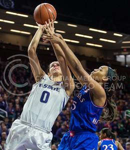Sophomore forward Jessica Sheble shoots through a defender on Jan. 11, 2014 at Bramlage Coliseum.  The Wildcats won against KU 58-52.  (Rodney Dimick | The Collegian)