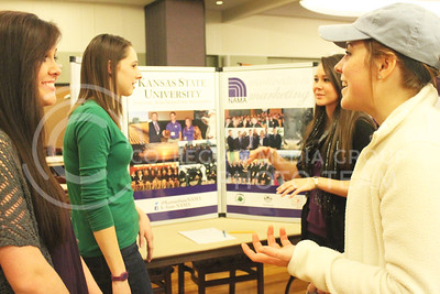 Molly Bertz, freshman in agriculture communications, shares information about her club NAMA to fellow student Jacqueline Clawson, freshman in agriculture economics and business marketing, in the Union Grand Ballroom at the Wildcat Winter Expo on Jan. 28, 2016.  (Emily Lenk | The Collegian)