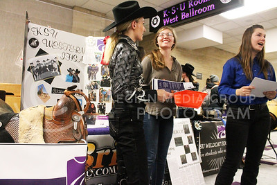 Marisa Mady, sophomore in animal science production management, talks with Hope Grable, sophomore in life scienes pre-med, and Bre Eulert, sophomore in animal science business, about their club KSU Western at the Wildcat Winter Expo on Jan. 28, 2016.   (Emily Lenk | The Collegian)