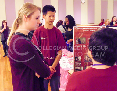 Left to right: Meghan Dugan, junior in food science, Mac Phrommamy, junior in secondary education, and Alex Rivarola, president of the Kansas State Rotaract Club, and sophomore in economics discuss what the Rotaract Club is about and what they have been doing this year on Jan. 28, 2016 at the Wildcat Winter Expo. (Jessica Robbins | The Collegian)