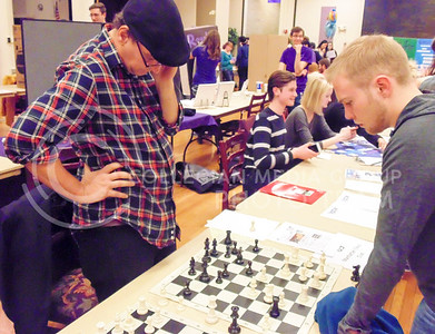 Ray Paul, advisor of the Chess Club, and Chris Baughman, freshman in parks management play a game of chess at the Wildcat Winter Expo in the Student Union Grand Ballroom on Jan. 28, 2016. (Jessica Robbins | The Collegian)