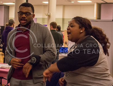 Gerrid Harris, junior in industrial engineering, and Casha Mills, senior in English literature, sings and dance to attract interest in Black United Voices at the Wildcat Winter Expo in the Union Ballroom at the Student Union on Jan. 28, 2016. (Miranda Snyder | The Collegian)