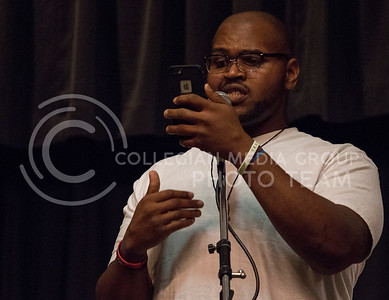 Cotorey Seals, Manhattan resident, performs original spoken word poetry during UPC's Open Mic Night in the Little Theater of the K-State Student Union on March 23, 2016. (Miranda Snyder | The Collegian)