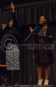 Charday Crawford (left), junior in psychology, sings with Dominique Brookshire, Manhattan resident, during UPC's Open Mic Night in the Little Theater of the K-State Student Union on March 23, 2016. (Miranda Snyder | The Collegian)