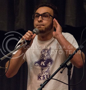 Ahmad Alnajjar, senior in political science, does a comedy routine during UPC's Open Mic Night in the Little Theater of the K-State Student Union on March 23, 2016. (Miranda Snyder | The Collegian)