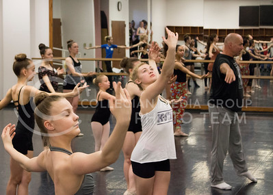Instructor Paul Zmolek conducts the ballet class for the Dance Day event in Nichols Hall on APril 01, 2016. (Jessica Robbins | The Collegian)