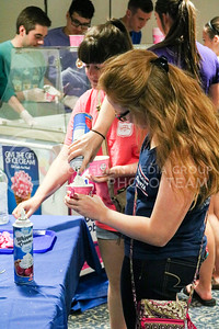 An attendee of the Kappa Kappa Gamma and Delta Sigma Phi Sundae Funday philanthropy event enjoys the toppings bar on April 3, 2016, at the Kappa Kappa Gamma house. (Matthew Zajic | The Collegian)