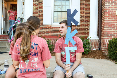 Matthew Mindrup, freshman in biology, holds a Kappa Kappa Gamma sign at the Kappa Kappa Gamma and Delta Sigma Phi Sundae Funday philanthropy event on April 3, 2016 at the Kappa Kappa Gamma house. (Matthew Zajic | The Collegian)