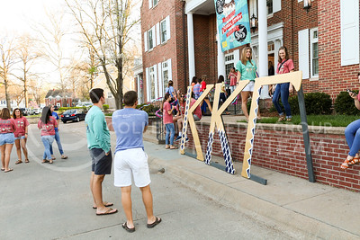 Attendees of the Kappa Kappa Gamma and Delta Sigman Phi Sundae Funday philanthropy event stand outside of the Kappa Kappa Gamma house on April 3, 2016. (Matthew Zajic | The Collegian)