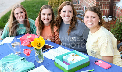 A group of Kappa Kappa Gamma sorority sisters works the front table at the Kappa Kappa Gamma and Delta Sigma Phi Sundae Funday philanthropy event on April 3, 2016, at the Kappa Kappa Gamma house. (Matthew Zajic | The Collegian)
