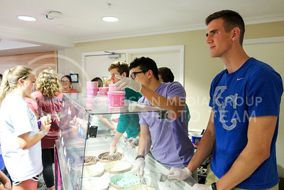 Matthew Tobaben, senior in biology, waits on an ice cream order at the Kappa Kappa Gamma and Delta Sigma Phi Sundae Funday philanthropy event on April 3, 2016, at the Kappa Kappa Gamma house. (Matthew Zajic | The Collegian)