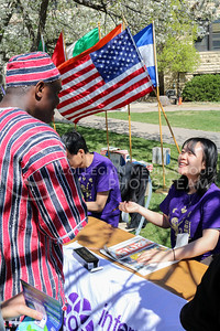Meco Dokpa, graduate student in Entomology, converses with Junye Liu, Game Day worker, while waiting to get his name written in Chinese at the International Week Game Day in the Quad on April 4, 2016. (Matthew Zajic | The Collegian)