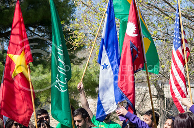 During a parade to celebrate International Week, students walked across campus carrying the flags of the various countries that have students attending K-State on April 4, 2016. (Miranda Snyder | The Collegian)