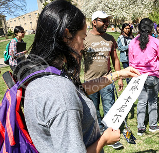 Erin Kuneyl, freshman in Architectural Engineering, looks at her name written in Chinese at the International Week Game Day in the Quad on April 4, 2016. (Matthew Zajic | The Collegian)