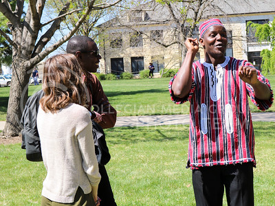 Meco Dokpa, graduate student in Entomology, converses with other participants at the International Week Game Day in the Quad on April 4, 2016. (Matthew Zajic | The Collegian)