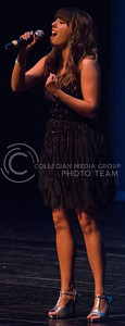 Jackie Newland, senior in ag communications and journalism, sings for the talent portion of the Miss K-State competition in McCain auditorium on April 12, 2016. (Miranda Snyder | The Collegian)