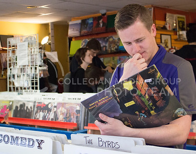 James Schmidt, junior in public relations, looks through vinyl records at Sisters of Sound for International Record Store Day on April 16, 2016. (Miranda Snyder | The Collegian)