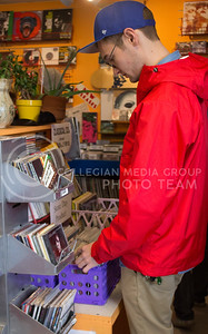 Hunter Gilson, graduate student in English, looks through music at Sisters of Sound for International Record Store Day on April 16, 2016. (Miranda Snyder | The Collegian)