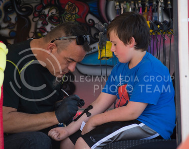 A boy gets an air-brushed tattoo at the Kansas State Fair in Hutchinson, Kansas on Sept. 12, 2015. (Cassandra Nguyen | The Collegian)