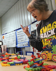 An exhibitor at the Kansas State Fair in Hutchinson this Saturday adamantly sells her IQ Booster toys. (Vail Moshiri | The Collegian)