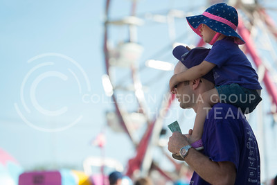Lilla Wanklyn plays with her dad, Kevin Wanklyn from Manhattan, in front of a farris wheel at the Kansas State Fair Saturday Sept. 12, 2015. (Photo by Evert Nelson | The Collegian)