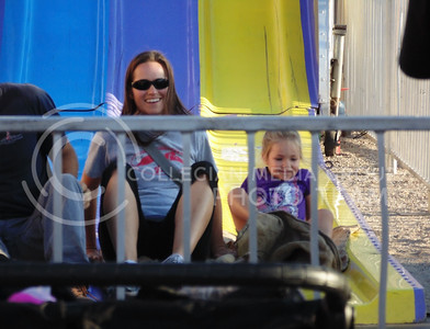 Kelsey Hett, and mother Stephanie Hett enjoys their time on the slides at the Kansas state fair, Sept. 12, 2015. (Jessica Robbins | The Collegian)