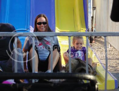 Kelsey Hett, and mother Stephanie Hett enjoys their time on the slides at the Kansas state fair, Sept. 12, 2015. (Jessica Robbins | The Collegian)