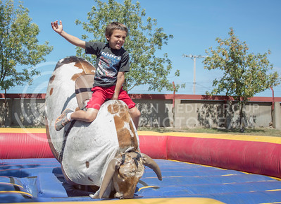 A boy rides a mechanical bull during the Kansas State Fair on Sept. 12, 2015. (George Walker | The Collegian)
