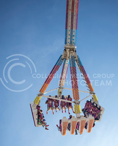 An amusment ride raises people high into the air during the Kansas State Fair on Sept. 12, 2015. (George Walker | The Collegian)