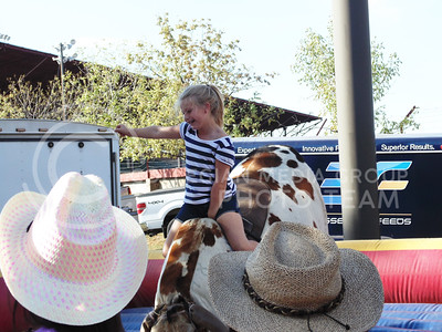 McKenna Leein from Wichita, Ks, rides the mechanical bull at the Kansas state fair Sept. 12, 2015. (Jessica Robbins | The Collegian)
