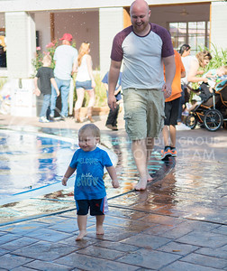 Bently Bonnette, 18 month old resident of Hutchinson, plays with uncle Tanner Fisher, resident of Lawrence, at the mini water park at the Kansas State Fair in Hutchinson, Kansas on Sept. 12, 2015. (Cassandra Nguyen | The Collegian)