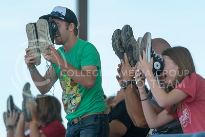 Josh Lightsey, from Hutchinson, uses his shoes as binoculars with other participants to laugh at the audience wearing embarrasing pajamas while under hypnosis by Ron Diamond during Diamonds show at the Kansas State Fair Saturday Sept. 12, 2015. (Photo by Evert Nelson | The Collegian)
